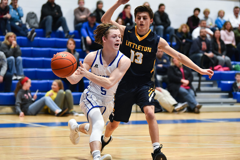 (01/30/18 LUNENBURG MA) Lunenburg senior captain Adam Peplowski (left) passes the ball toward the net in Tuesday night's boys varsity basketball game at home against Littleton. SENTINEL & ENTERPRISE JEFF PORTER