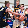 (01/30/18 LUNENBURG MA)Littleton senior captain Mitch Crory (left) steals the ball from Lunenburg senior Troy Howe as he rushes the net in Tuesday night's boys varsity basketball game at home against Littleton.  SENTINEL & ENTERPRISE JEFF PORTER