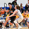 (01/30/18 LUNENBURG MA)Littleton junior Ross Cotnam (left) carries the ball to the net with pressure from Knights senior captain Adam Peplowski in Tuesday night's boys varsity basketball game at Lunenburg High School. Littleton won the game, 47-35. SENTINEL & ENTERPRISE JEFF PORTER