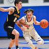 (01/30/18 LUNENBURG MA) Littleton junior PJ Barbella (left) puts defensive pressure on Knights senior captain Adam Peplowski in Tuesday night's boys varsity basketball game at Lunenburg High School.  SENTINEL & ENTERPRISE JEFF PORTER