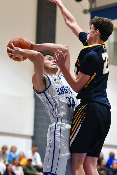 (01/30/18 LUNENBURG MA) Lunenburg senior captain Connor Palma (left) shoots the ball with pressure from Tigers junior Ross Cotnam in Tuesday nights game at home.  SENTINEL & ENTERPRISE JEFF PORTER