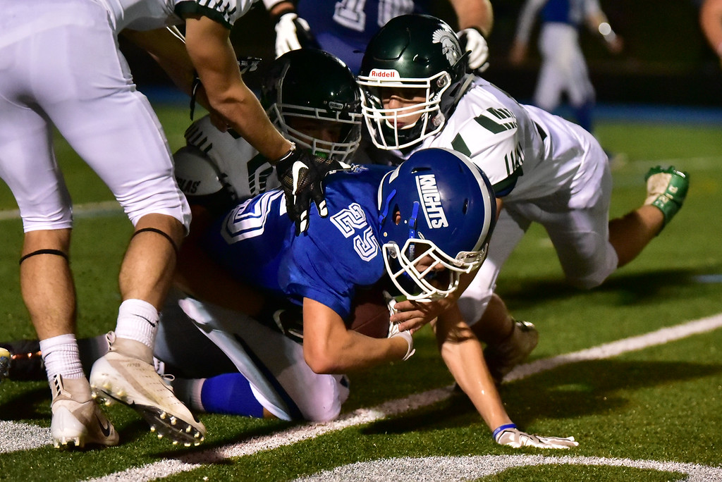 . Lunenburg junior Cameron Mackenzie (25) is taken down on Oakmont\'s 20 yard line in Friday nights varsity football game at Lunenburg High School.  SENTINEL & ENTERPRISE JEFF PORTER