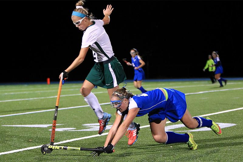 Oakmonts Lauren Ladue jumps over the stick of Elizabeth Abare