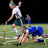 Oakmonts Lauren Ladue jumps over the stick of Elizabeth Abare