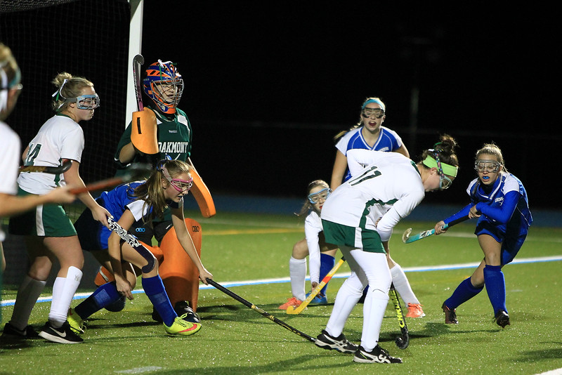 Oakmonts Rachael Lemay gets the ball out of the front of the net