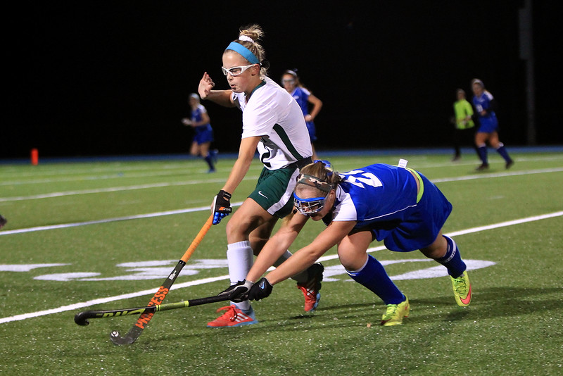 Oakmont Regional's Lauren Ladue, left, and Lunenburg's Elizabeth Abare fight for the ball during Tuesday night's Central Mass. Division 2 field hockey semifinal game at Lunenburg High School on Nov. 8, 2016. SENTINEL & ENTERPRISE / SCOTT LAPRADE