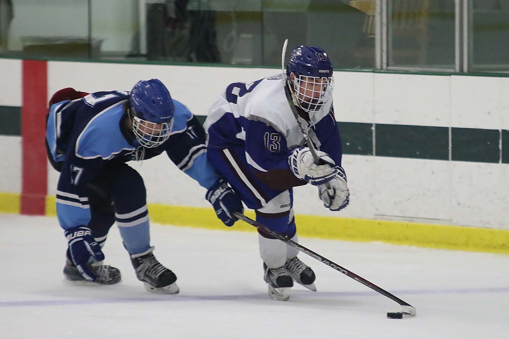 . Lunenburg/Ayer Shirley played Worcester at the Fitchburg State University\'s Wallace Civic Center on Friday night. Worcester\'s Ryan Vigeant reachs to try and get the puck away from Lunenburgs Luke Dufresne during action in the game. SENTINEL & ENTERPRISE/JOHN LOVE