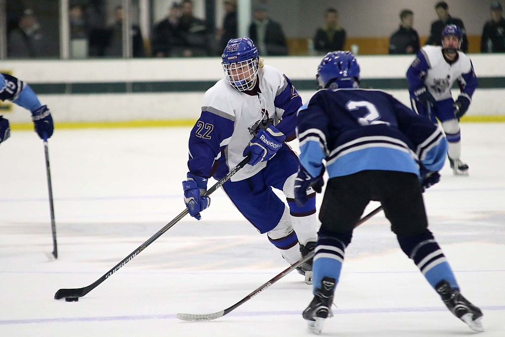 . Lunenburg/Ayer Shirley played Worcester at the Fitchburg State University\'s Wallace Civic Center on Friday night. Lunenburg\'s Jared Albert brings the puck down court towards waiting Worcester player Daniel Sheeran. SENTINEL & ENTERPRISE/JOHN LOVE