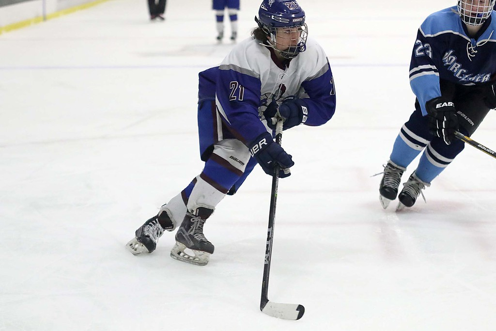 . Lunenburg/Ayer Shirley played Worcester at the Fitchburg State University\'s Wallace Civic Center on Friday night. Lunenburg\'s Nathan Handy takes the puck towards the net during action in the game. SENTINEL & ENTERPRISE/JOHN LOVE
