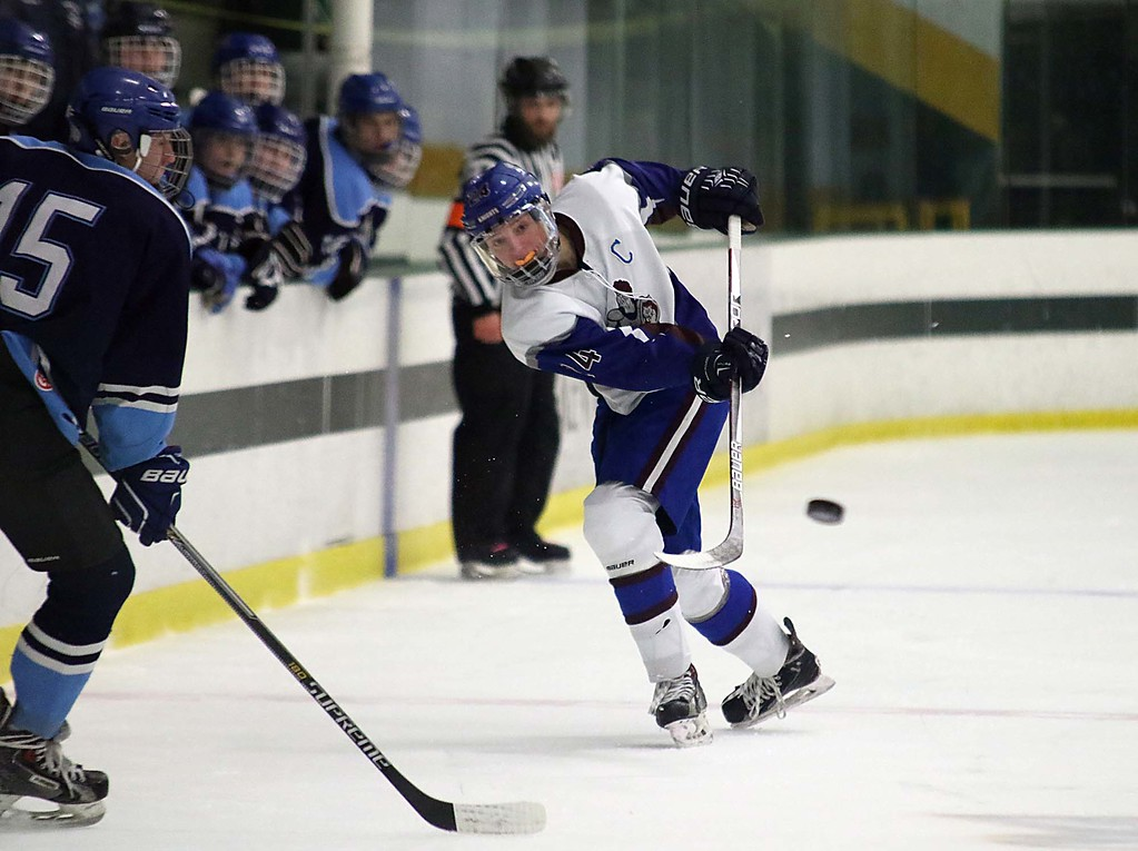 . Lunenburg/Ayer Shirley played Worcester at the Fitchburg State University\'s Wallace Civic Center on Friday night. Lunenburg\'s Max Simmons fires a shot towards the goal during action in the game. SENTINEL & ENTERPRISE/JOHN LOVE