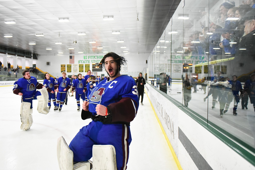 . (03/11/18 FITCHBURG MA) senior captain Nathan Bourdelais skates past Lunenburg/Ayer fans after winning  Sunday\'s Div. 3A Central boys hockey final against Grafton at the Wallace Civic Center in Fitchburg. SENTINEL & ENTERPRISE JEFF PORTER