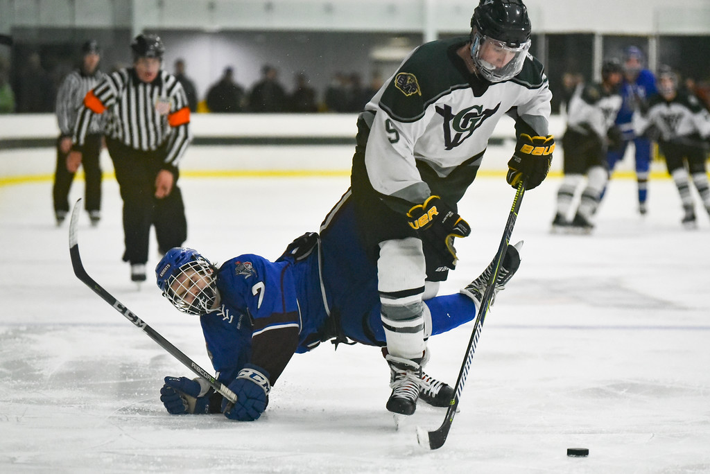 . (03/11/18 FITCHBURG MA)  Lunenburg/Ayer junior Jacob Mauro (left) is knocked off the puck by Grafton junior Tyler Baker in Sunday\'s Div. 3A Central boys hockey final at the Wallace Civic Center in Fitchburg. SENTINEL & ENTERPRISE JEFF PORTER