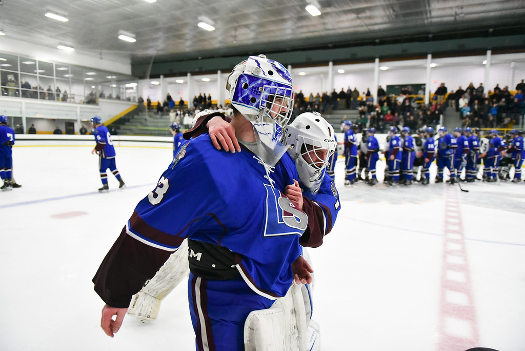 . (03/11/18 FITCHBURG MA) Senior Goalie Nathan Bourdelais (left) and junior Anthony Firmani celebrates a win over Grafton in Sunday\'s Div. 3A Central boys hockey final at the Wallace Civic Center in Fitchburg. SENTINEL & ENTERPRISE JEFF PORTER
