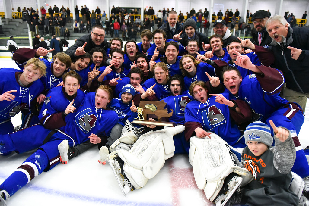 . (03/11/18 FITCHBURG MA) Lunenburg/Ayer boys varsity hockey pose with the MIAA Div. 3A Central boys hockey after a 5-1 win over Grafton on Sunday at the Wallace Civic Center in Fitchburg. SENTINEL & ENTERPRISE JEFF PORTER