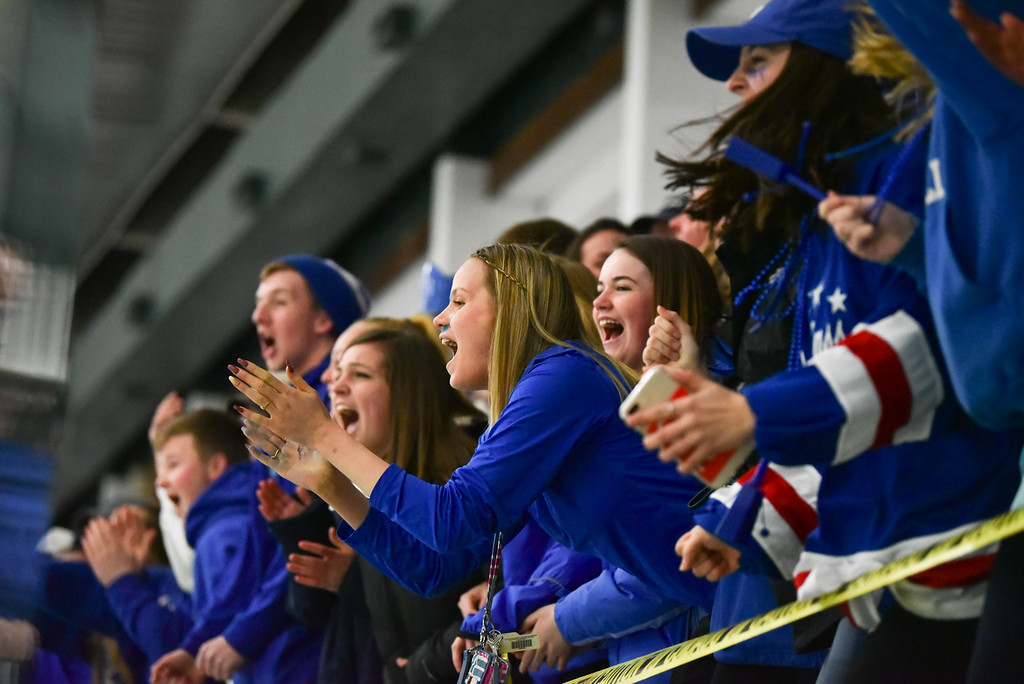 . (03/11/18 FITCHBURG MA) Lunenburg Ayer fans cheer as the Knights put the puck away in the first period of play in Sunday\'s Div. 3A Central boys hockey final against Grafton at the Wallace Civic Center in Fitchburg. SENTINEL & ENTERPRISE JEFF PORTER