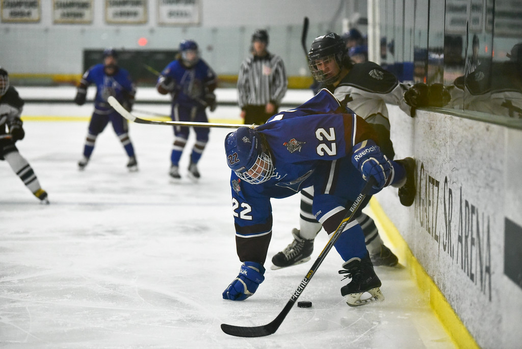 . (03/11/18 FITCHBURG MA) Lunenburg/Ayer junior Jared Albert (22) skates through Grafton defender in Sunday\'s Div. 3A Central boys hockey final at the Wallace Civic Center in Fitchburg. SENTINEL & ENTERPRISE JEFF PORTER