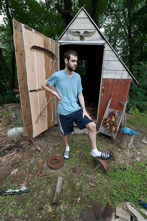 . Kevin Boussom, 18, talks about his new scrap metal art he is creating at his home in Lunenburg, Tuesday August 21, 2018. He stands in his backyard among some of the stuff he has collected for his pieces as he talks about his art. SENTINEL & ENTERPRISE/JOHN LOVE