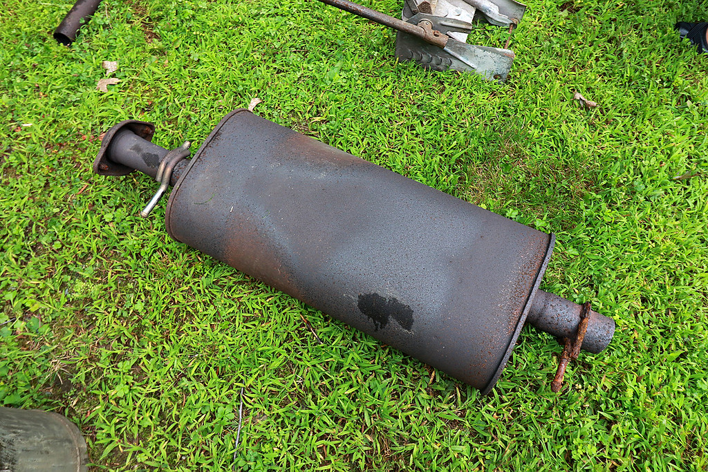 . Kevin Boussom, 18, talks about his new scrap metal art he is creating at his home in Lunenburg, Tuesday August 21, 2018. He has lot of stuff in his backyard that he has collected for his pieces, like this old muffler. SENTINEL & ENTERPRISE/JOHN LOVE