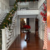 Everything is just so festive, including banister with greens, lights, bows and berries and more.