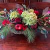 A fresh floral arrangement by Faith graces the kitchen table.