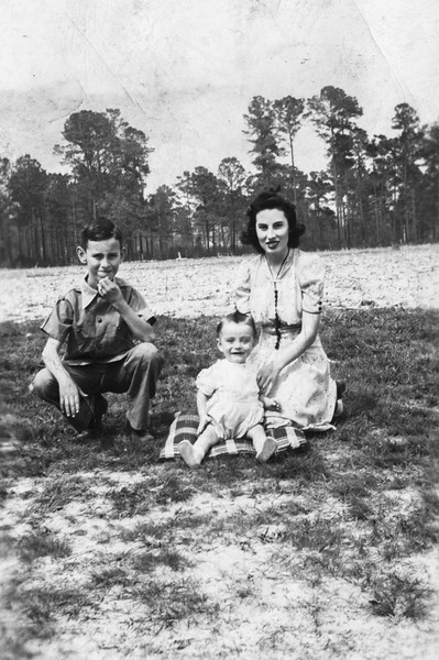 Luther Chesson, Marjorie Chesson, and their infant nephew, Parker Chesson.<br /> <br /> Photo taken about 1942.<br /> <br /> Location: Stokes farm south of Hertford on US 17. Luther and Marjorie's father, Jesse Pyron Chesson, rented the farm and house in the 1930's and early 1940's from Henry Stokes. The house was constructed prior to the Civil War.<br /> <br /> Parker was born in the farm house on August 19, 1941. His parents had moved in with his grandparents shortly before the start of World War II.