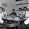 Parker and Wynda Chesson moved to Elizabeth City in the summer of 1964. They lived at 1704 Wesley Drive in the Oxford Heights community. We had the Chesson family for a meal soon after we got settled. <br /> <br /> Left to right: Parker Chesson, Jake Chesson, Anna Chesson, Katherine Chesson, Luther Chesson, and the arm of Granddaddy Chesson. Wynda, Eva Chesson, and Grandmother Chesson are not visible in the photo.