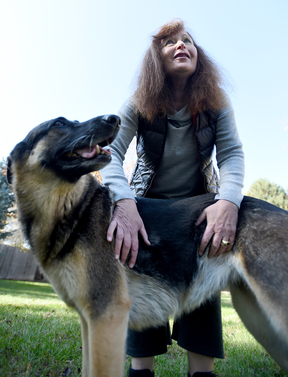 . Fran Blum plays with one of her own dogs, Sheila Rose, in the backyard. Fran Blum, of Boulder, has a business that makes luxury coats for dogs. Cliff Grassmick  Staff Photographer October 13, 2017