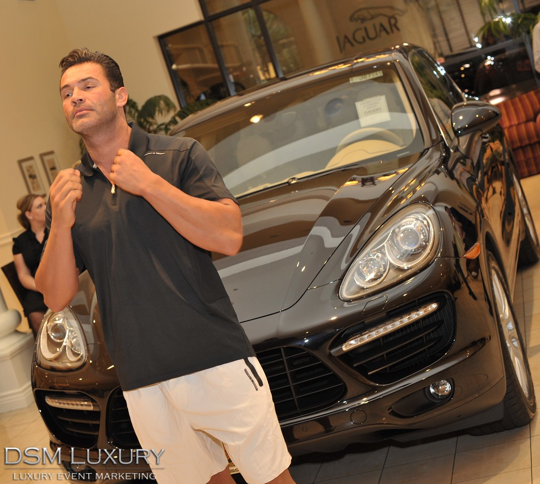 Gaudin Porsche in Las Vegas unveiled the new 2011 Porsche Cayenne last night in a fireworks of good times thanks to sponors Gaudin, Porsche Design, Eccoci Fashions, Cars & Coffee, The Weiland Group, The Tailored Man, Bretts & Scholl, Dark & Stormy Goslings Rum and Terrisa & Company Models.<br /> Photographs by Mark Bowers, Las Vegas photographer.