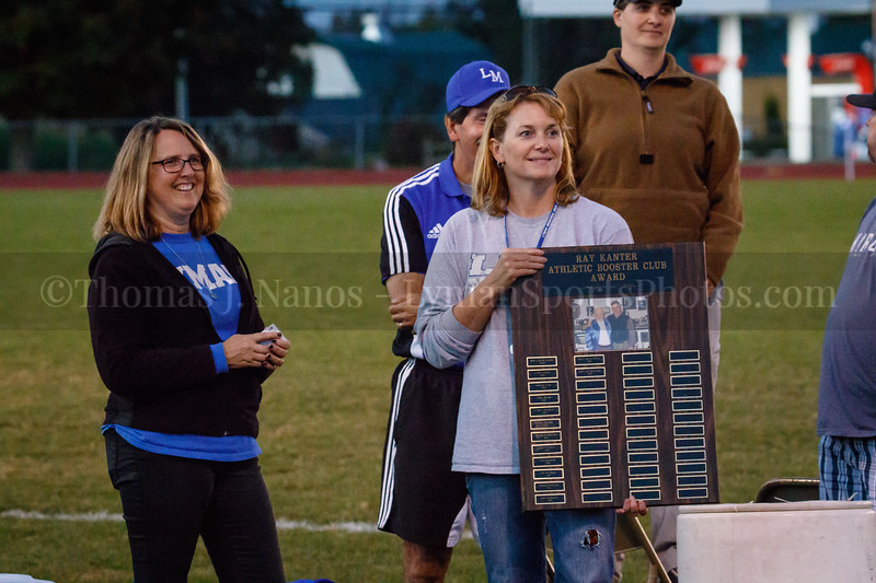 Lyman Booster Club Co-Presidents Susan Vigue (L) and Barb Archer (R) present the Ray Kanter Award before the game - Lyman Memorial High School Girls Soccer vs St. Bernards