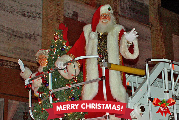 Santa and Mrs. Claus on a fire truck