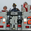 Santa and Mrs. Claus with a fireman
