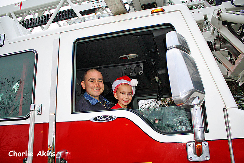 Father and son in the fire truck