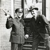 Officer Duff with Civilian in front of Theater  (06685)