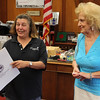 Lynn, Ma. 6-20-17. Mayor Judith Flanagan Kennedy presents Estelle Revelotis with a citation for her many roles in service to Lynn inculding secretary to Father Mihos, and clerk in Lynn Public School Department.