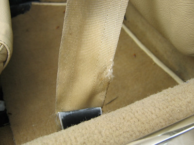 Seat belt frayed - possible safety hazard