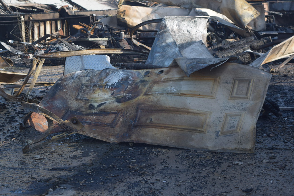""". A Lyon Township home, 24315 Douglass Drive, was destroyed by a fire around 4 a.m. Wednesday, Aug. 9, 2017. Homeowner Don Parvu said he and his wife were awoken by their daughter who heard \""""something blow up\"""". Parvu said he lost one of his two dogs in the fire. (Mark Cavitt/The Oakland Press)"""