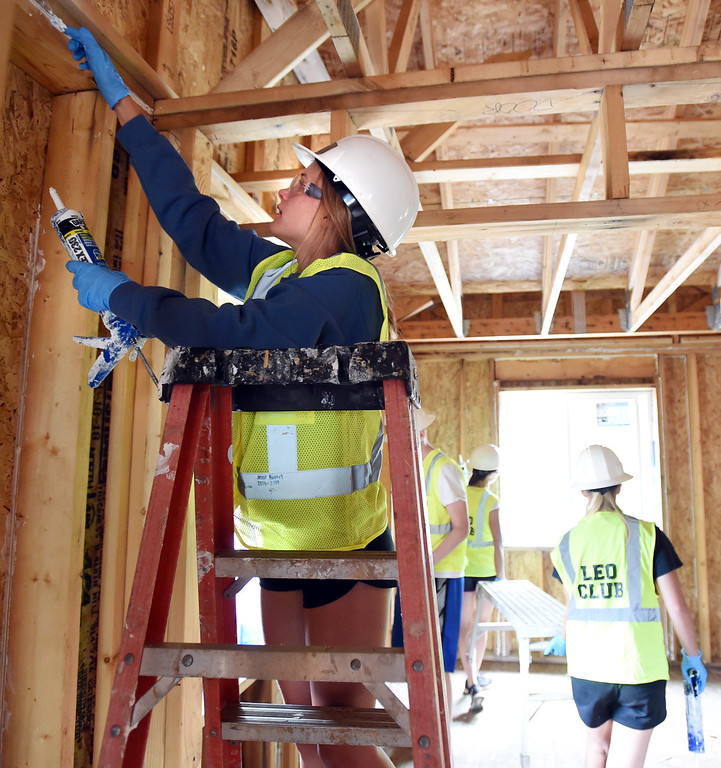 . Jesse Bartel, a junior at Lyons high school, does caulking inside one of the new homes. The youth service arm of the Lyons club is helping with the Lyons town home project, in coordination with Habitat for Humanity. They are working on homes damaged in the 2013 flood.  Cliff Grassmick / Staff Photographer/ June 30, 2018