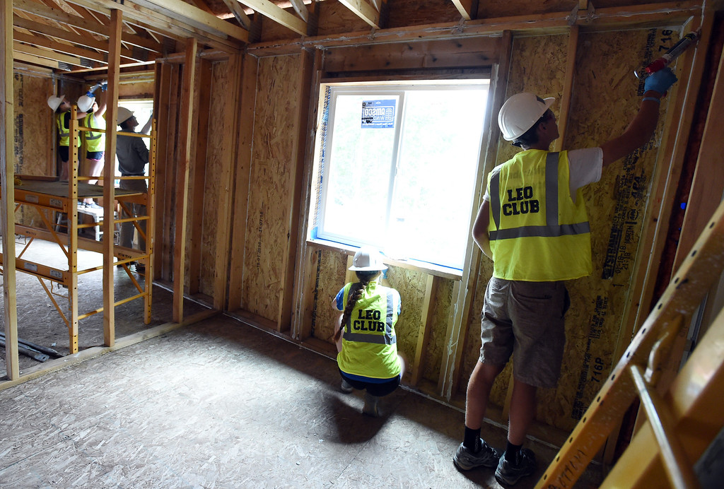 . A group from Lyons High School, called the Leos, works on a new home on Saturday. The youth service arm of the Lyons club is helping with the Lyons town home project, in coordination with Habitat for Humanity. They are working on homes damaged in the 2013 flood.  Cliff Grassmick / Staff Photographer/ June 30, 2018