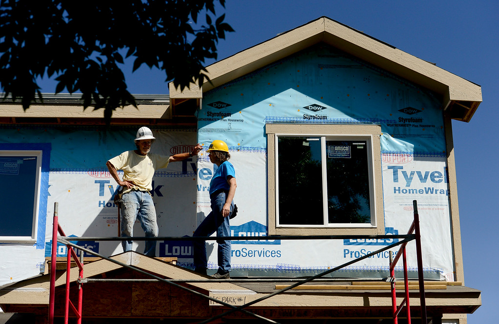 . LYONS, CO,  AUGUST 29: John Holloway, of Lyons, talks with Shelia Hufnagel, of Boulder, while working on a Habitat for Humanity duplex being built on the 100 Block of Park Street in Lyons on Aug. 29, 2018. The Park Street Development project is designated for families that survived the flood of 2013. (Photo by Matthew Jonas/Staff Photographer