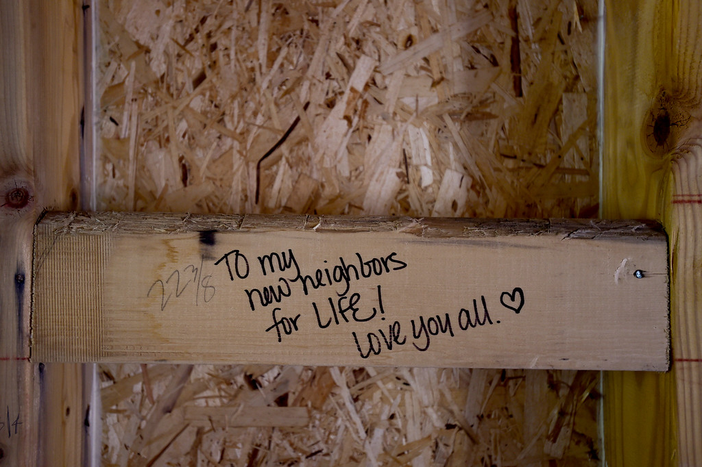 . LYONS, CO,  AUGUST 29: A note written on an unfinished wall is seen in a Habitat for Humanity duplex being built on the 100 Block of Park Street in Lyons on Aug. 29, 2018. The Park Street Development project is designated for families that survived the flood of 2013. (Photo by Matthew Jonas/Staff Photographer