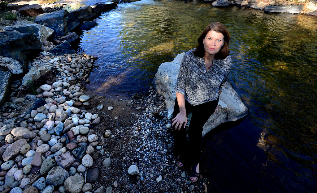 . Victoria Simonsen, Town Administrator of Lyons Colorado in the St. Vrain Creek in Bohn Park on Thursday August 30 2018.  (Photo by Paul Aiken/Staff Photographer)