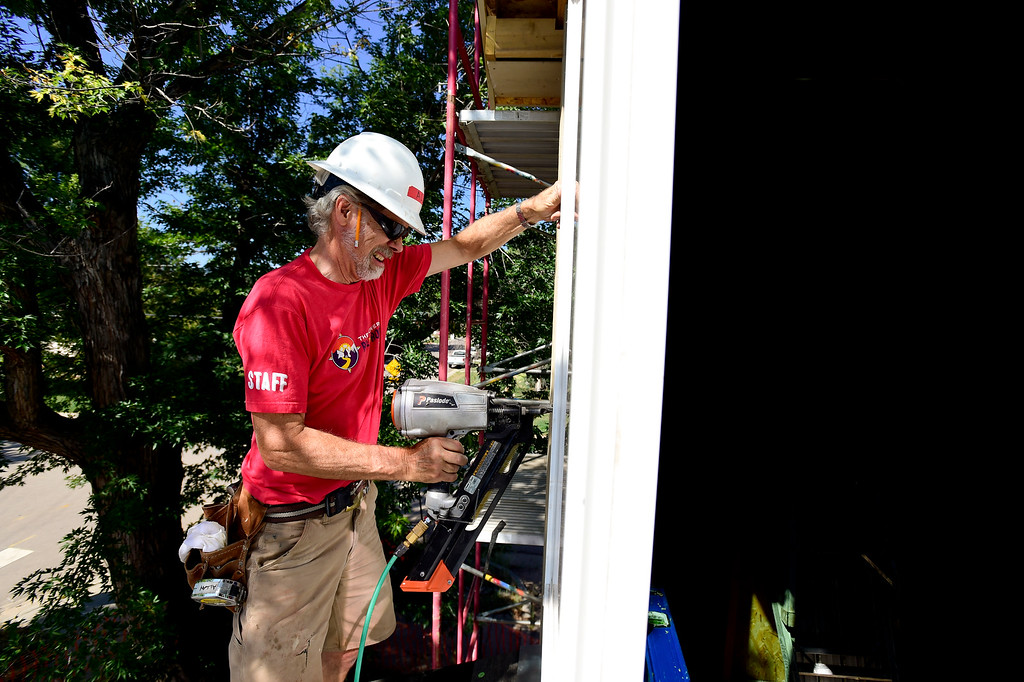 . LYONS, CO,  AUGUST 29: Allan Trumpler, of Niwot, works on trim around a window on a Habitat for Humanity duplex being built on the 100 Block of Park Street in Lyons on Aug. 29, 2018. The Park Street Development project is designated for families that survived the flood of 2013. (Photo by Matthew Jonas/Staff Photographer