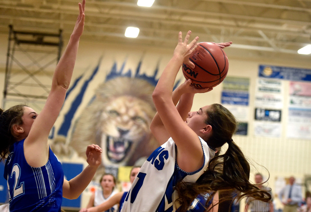 . LYONS, CO - JANUARY 29, 2019: Lyons High School\'s Jazmyn Enny takes a shot over Alexandr Dunbar during a game against Dawson on Tuesday in Lyons. More photos: BoCoPreps.com(Photo by Jeremy Papasso/Staff Photographer)