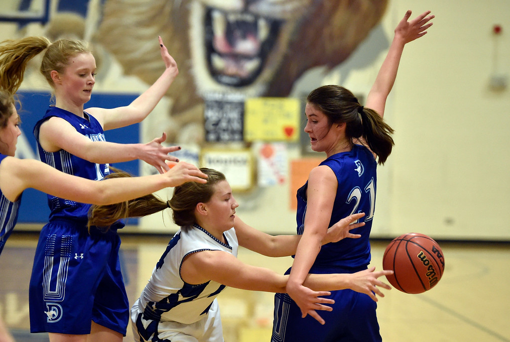 . LYONS, CO - JANUARY 29, 2019: Lyons High School\'s Avery Joy passes under the arms of Maddy Timms during a game against Dawson on Tuesday in Lyons. More photos: BoCoPreps.com(Photo by Jeremy Papasso/Staff Photographer)