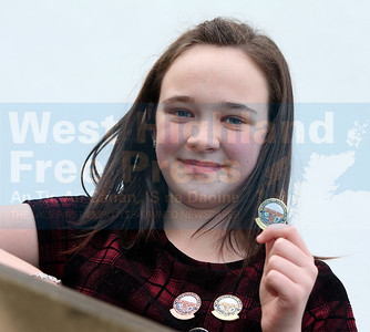 Molly Fox , a member of Clan Throndairnis, was the winner of the traditional sgeulachd 11-12.