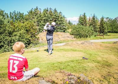 Arnór Ingi Finnbjörnsson, GR, slær á 2. teig á Garðavelli. Leikmaður Vals fygist með, Þorsteinn Ígor.  Mynd/seth@golf.is