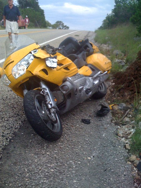 4:00PM  9/11/08. 8 miles West of Leakey, TX on 337.  70mph. Hit by a small deer.  End of my wonderful GoldWing.  Totaled.  Luckily I wasn't after tumbling down the road.  Full face helmet saved my face & head from major scrapes or more.  My riding friend, Mike M., was in front of me over the hill when the deer hit.   A stranger stopped to help me & called 911. Luckily Leakey had an EMT/Ambulance. Other drivers notified Mike M. over the hill waiting that I was down. I encouraged him to take the pics.  The 13th deer we had seen that day was the one that got me.
