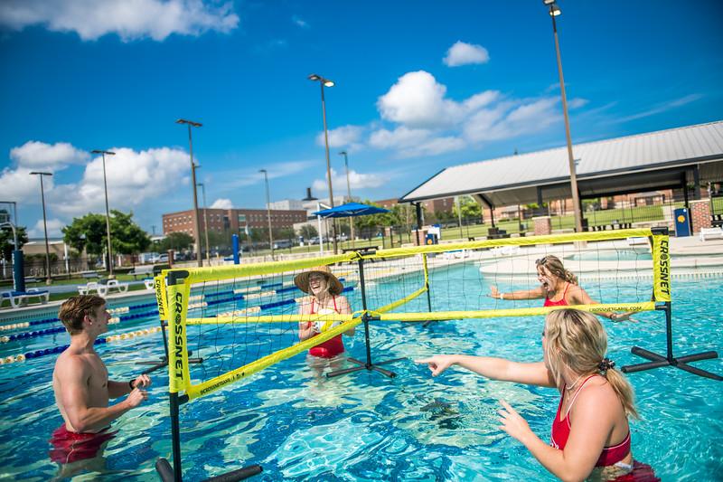 M21086- Campus Rec Pool, Lifeguards playing-1155