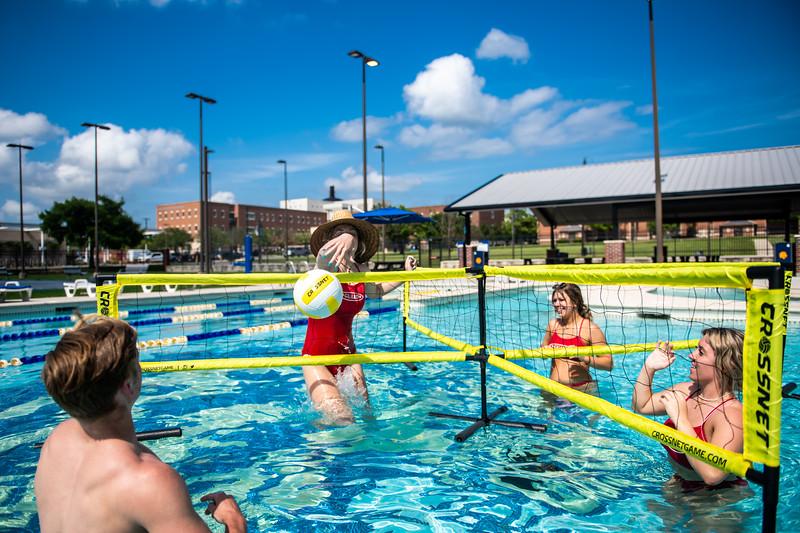 M21086- Campus Rec Pool, Lifeguards playing-1173