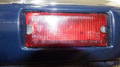 Non-original Toyota reflector installed to rear bumper